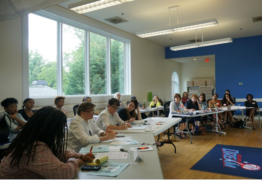 Partners discussing policy issues during the YWCA-hosted Roundtable meeting.
